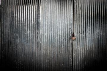 Wall Mural - Closeup of the zinc sheets door with lock