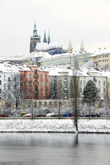 Christmas snowy Prague gothic Castle above River Vltava, Czech Republic