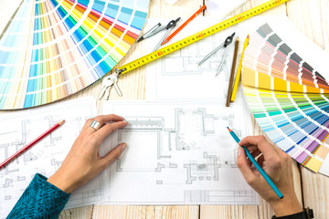 Workplace designer architect decorator. Drawings and planning. Female hand top view. Professional for the creative process of the work