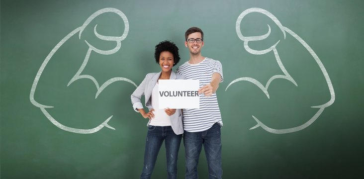 Portrait of a happy couple holding a volunteer card