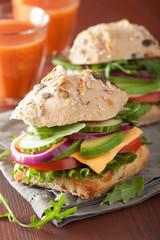 tomato avocado cheese sandwich with cucumber onion