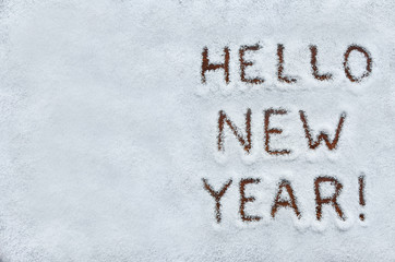 Text HELLO NEW YEAR written on snow. Horizontal postcard with sp