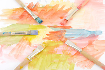 Paintbrushes on colorful painting