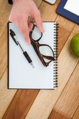 Businessman taking eyeglasses