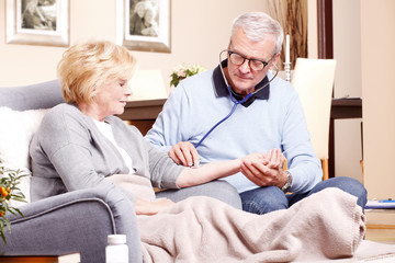 Senior doctor and elderly patient
