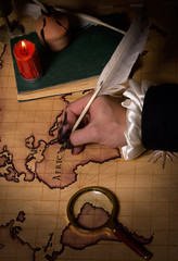 hand that draws the map
