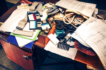 Messy workplace with paper on table