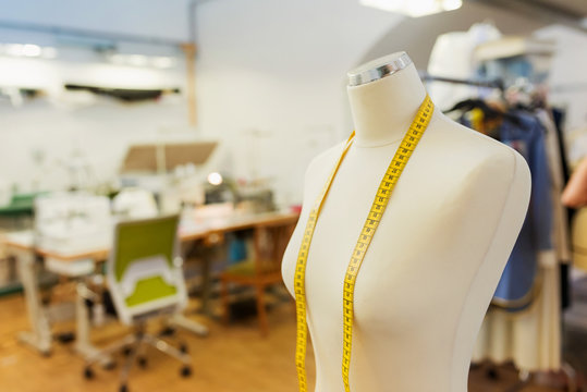 Tailors dummy with measure tape