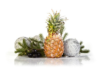 Pineapple with tree branch and christmas balls