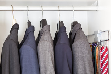 Suits and ties in wardrobe