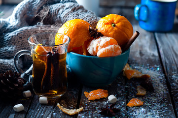 Tangerine in scarf over wooden background