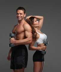 Muscular fitness men and a woman.