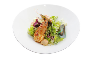 salad with seafood in a white plate isolated