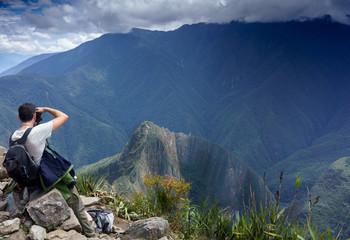 Rear view of a photographer taking picture of Machu Picchu, Cusco Region, Urubamba Province, Machupicchu District, Peru
