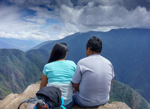 Rear view of a couple looking at mountains view in Machu Picchu, Cusco Region, Urubamba Province, Machupicchu District, Peru