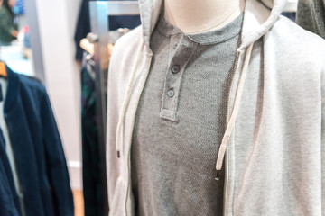 Mannequin displaying hood clothing in clothes store