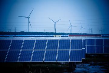 Green energy - solar panels and wind turbine.