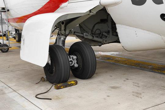 Wheel chocks deployed on an airplanes landing gear