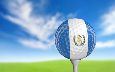 Golf ball with Guatemala flag colors sitting on a tee