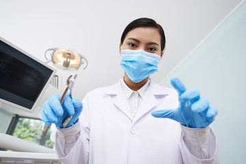 Dentist with pliers