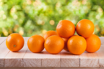 Fresh orange on wood with blur bokeh background