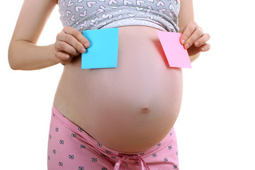 a pregnant woman in pyjamas holding a blue and pink paper isolated on white background