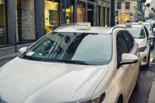 white taxi in Milan