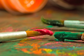 image of paints and brushes closeup