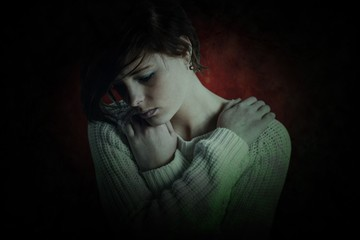 Composite image of sad brunette thinking with arms crossed