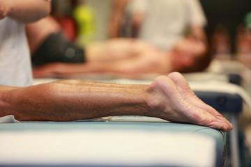 after running  -  waiting for massage,runner legs in focus