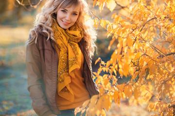 Beautiful woman in autumn park.