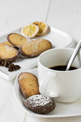 Assorted Cookies with coffee on wooden table