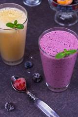 Frozen summer berries and banana milkshake garnished with mint