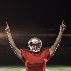 Composite image of american football player with arms raised