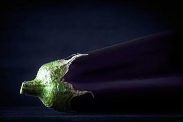 Aubergine  on the dark background