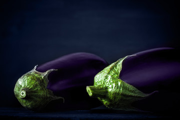 Eggplants on the dark background