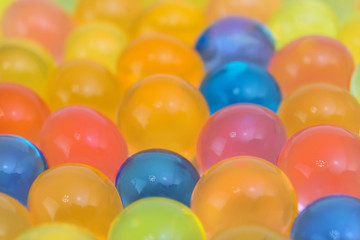colorful gel balls with blurred background