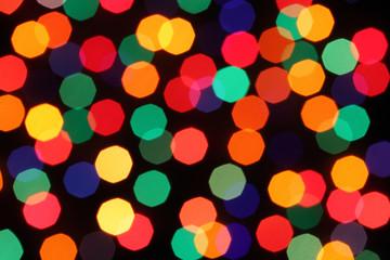 Light garlands on dark background. Christmas lights background.