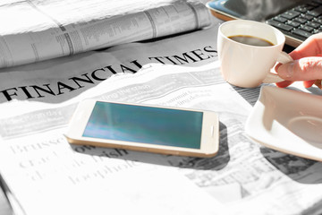 Newspaper with coffee