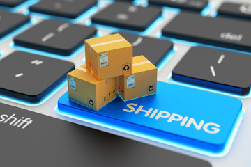 Internet shopping, online purchases, e-commerce, packages delivery and shipping service concept, cardboard boxes on computer keyboard key closeup view