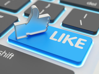 Social media networking and global internet communication concept, closeup view of thumbs up hand symbol on computer keyboard button with like word on it