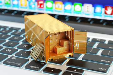 E-commerce, packages delivery, shipping service and freight transportation concept, open cargo container full of cardboard boxes on computer laptop keyboard closeup view