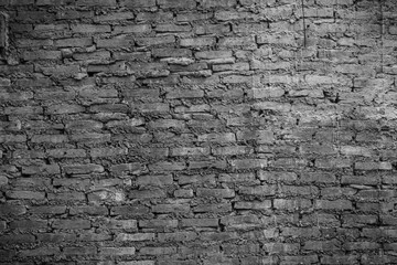 Wall Mural - Closeup of the old and weathered brick wall  in black and white