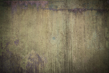 Wall Mural - Closeup of the old and weathered green wall