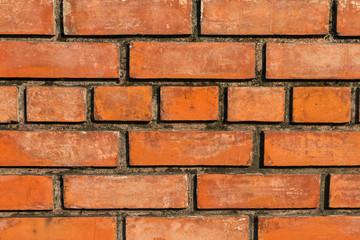 Wall Mural - Closeup of the red brick wall