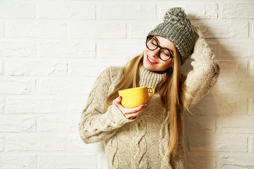 Romantic Dreaming Hipster Girl in Winter Clothes with a Mug