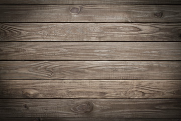 Wooden background with vignette effect.