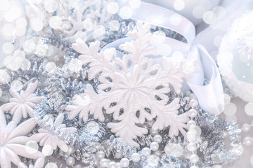 Unfocused silver and white snowflake glitter bokeh holiday background. Winter xmas holidays. Christmas..