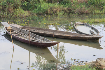 old wooden boats with boat filled of the water on the lake