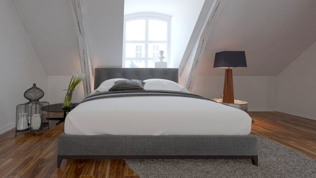 Bedroom interior with bed under a roof slope